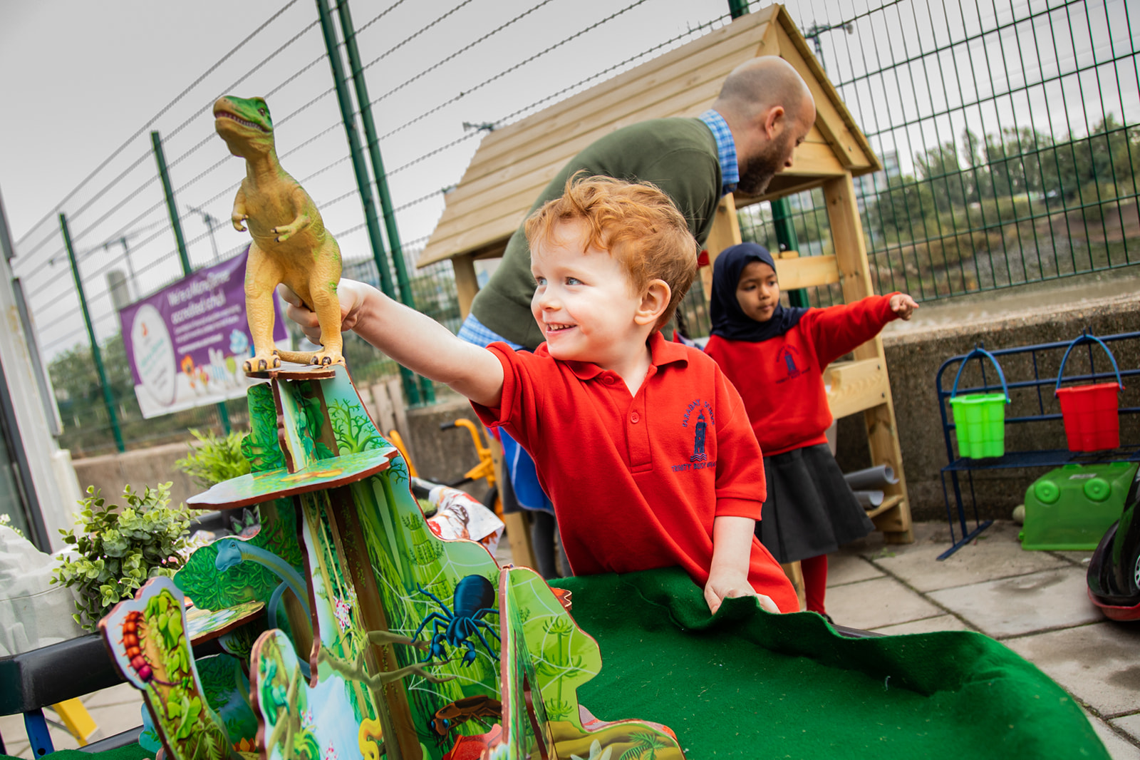 boy pupil playing in Reception playground