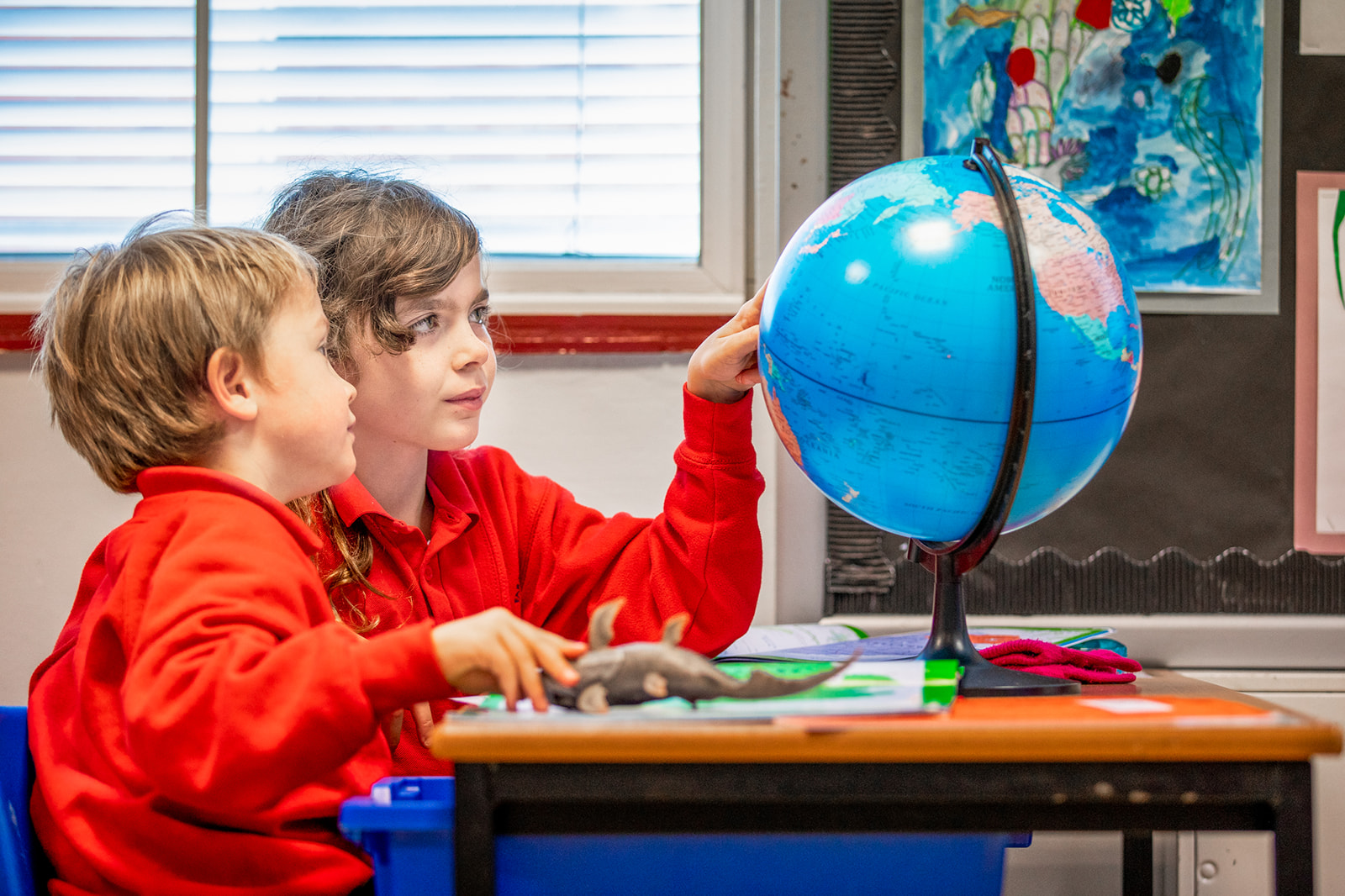 Faraday children learning with globe