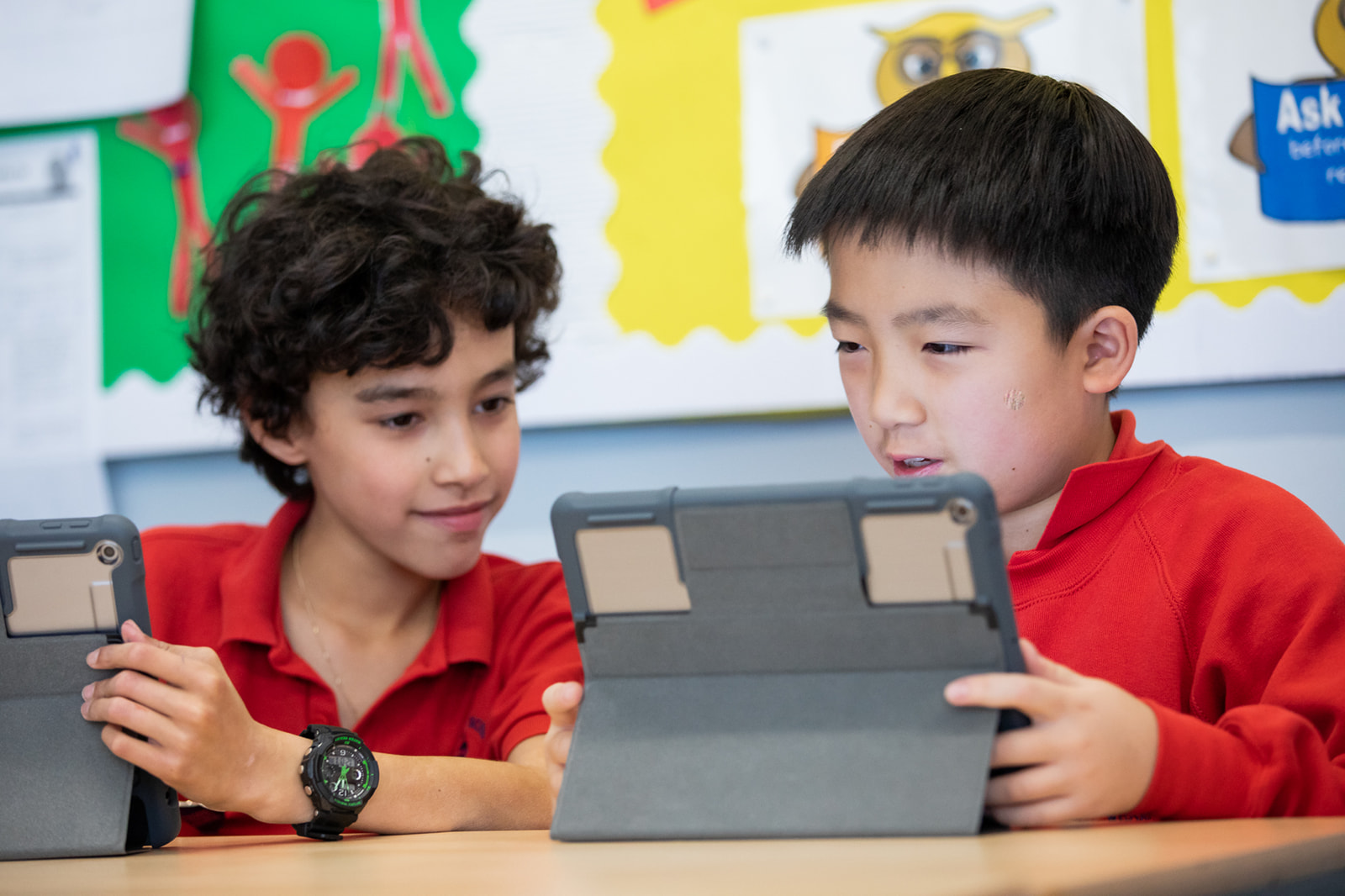 Pupils working together in class on IPads