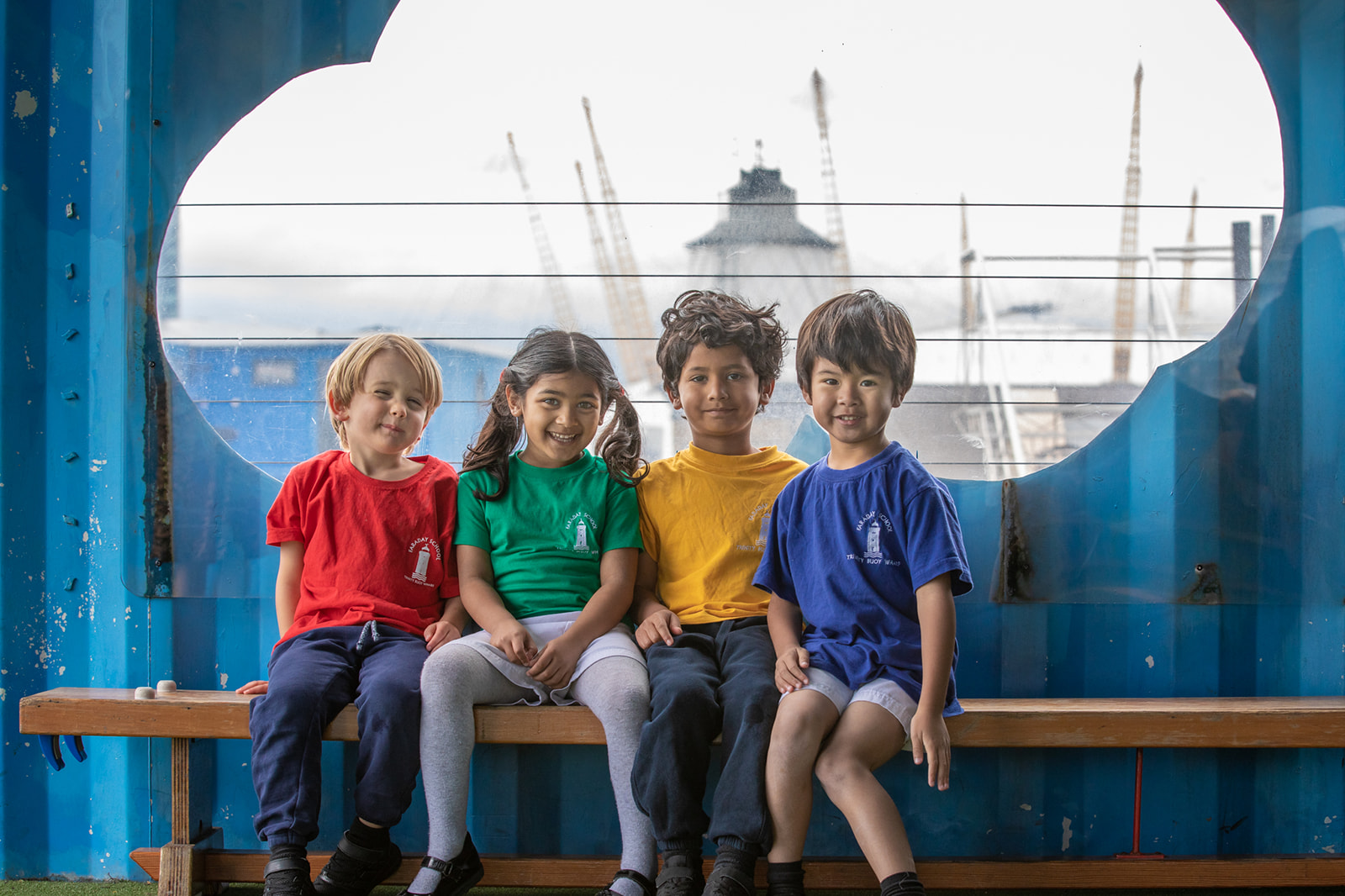 children smiling with view of lighthouse